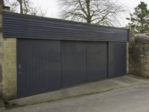 Sliding hardwood tongue and groove garage doors